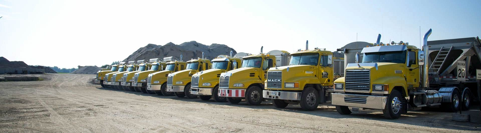 fleet of gravel trucks